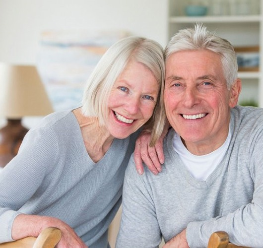 older couple wearing gray sweaters