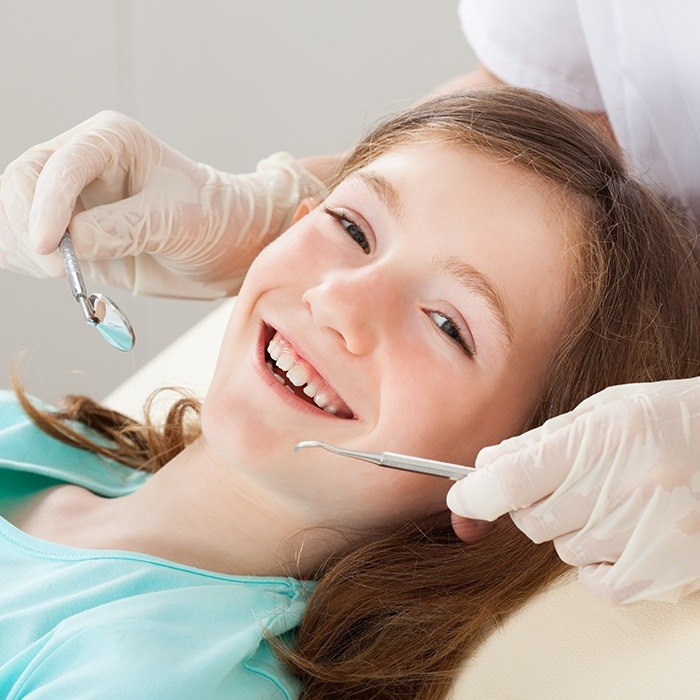 Smiling child during dental exam